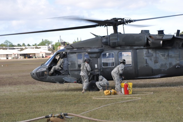 A UH-60 Black Hawk helicopter, assigned to 2nd Assault Helicopter Battalion, 25th Aviation Regiment, 25th Combat Aviation Brigade, re-fuels during an air assault exercise at Wheeler Army Airfield, Nov. 30.  (Photo by Sgt. Karl Williams   25th Combat Aviation Brigade Public Affairs)