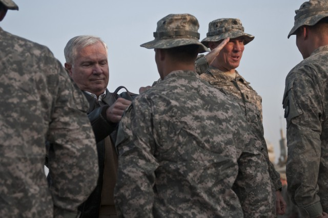 NANGARHAR PROVINCE, Afghanistan - Secretary of Defense Robert M. Gates presents the Combat Action Badge to U.S. Army Spc. Christian J. Roming, a cavalry scout from Kenner, La., assigned to 1st Squadron, 61st Cavalry Regiment, Task Force Panther, 4th Brigade Combat Team, 101st Airborne Division, with U.S. Army Lt. Col. William B. Johnson from Bristol, Tenn., Task Force Panther commander, at Forward Operating Base Connolly in eastern Afghanistan Dec. 7. (Photo by U.S. Army Staff Sgt. Mark Burrell, Task Force Bastogne Public Affairs)