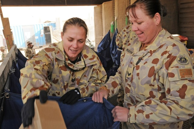 Sgt. Lisa Roberts (left) and Cpl. Jo Rootham (right) sort mail at Australian post office at Multi National Base Tarin Kot, Afghanistan, Dec. 8. More than six tons of mail will arrive over the next week. (U.S. Army photo by Spc. Jennifer Spradlin, 16th Mobile Public Affairs Detachment)