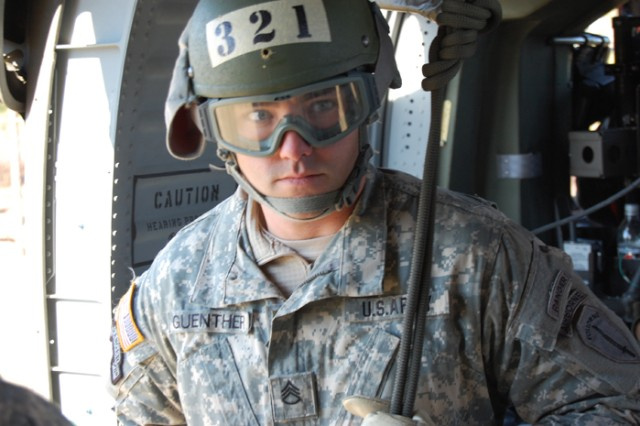 Staff Sgt. Daniel Guenther, of the 4th Ranger Training Battalion, prepares to rappel Thursday. To prepare for the event, students conducted multiple rappels from a tower.