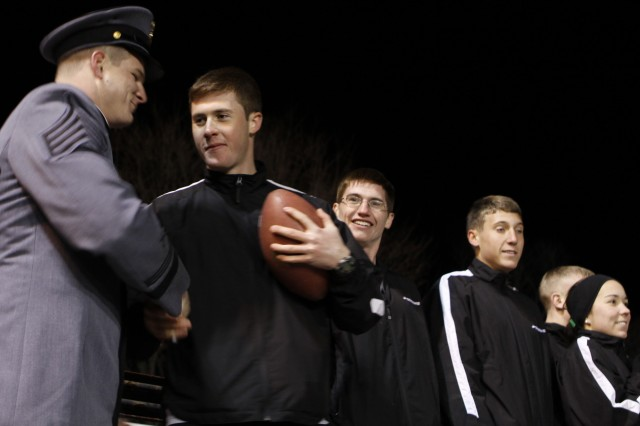 Black Knights team captain Stephen Anderson (Class of 2011) hands the game ball to the Marathon Team captain, who then led his teammates through the Corps of Cadets and out of West Point for a more-than-170-mile run to Philadelphia.