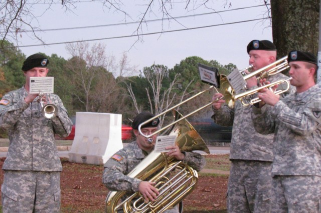 Members of the AMC Band get the crowd ready for action with a few Christmas carols.