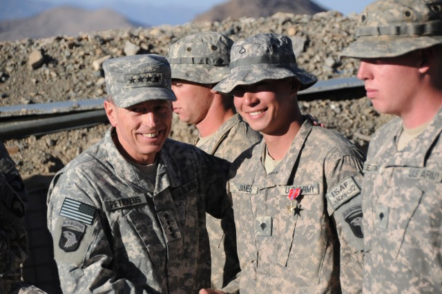 Gen. David H. Petraeus, International Security Assistance Force commander, shakes the hand of Spc. Timothy James after pinning him with a Bronze Star Medal with Valor at Combat Outpost Margah Nov. 11. James, an infantryman with Company C, 2nd Battalion, 506th Infantry Regiment, 4th Brigade Combat Team, 101st Airborne Division, received the medal and a battlefield promotion from private first class to specialist for his actions during an Oct. 30 attack.
