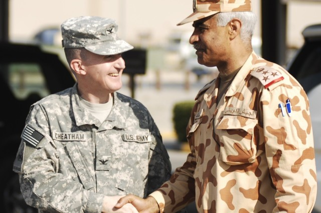 """CAMP ARIFJAN, Kuwait - Col. Robert G. Cheatham, Area Support Group - Kuwait commander (left), greets Kuwaiti Brig. Gen. Mohammed Al Khether, 25th Commando Brigade Special Forces commanding general (right), at the ASG-K headquarters for Third Army Dec. 9 at Camp Arifjan, Kuwait.  Brig. Gen. Khether and Col. Cheatham planted two palm trees as a symbol of solidarity between Kuwaiti and U.S. forces.  """"We've had a relationship since the Gulf War when the U.S. Army came to Kuwait,"""" Brig. Gen. Khether said. """"The Kuwaiti people and the Kuwaiti government still appreciate what the U.S. military did at that time."""""""