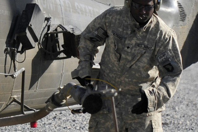 Spc. Clyde Tyrone Adams, Jr., E Troop, Task Force Saber petroleum supply specialist finishes fueling a UH-60 Black Hawk helicopter Nov. 30,2010 at Forward Operating Base Wilson, Afghanistan. (U.S. Army Photo by Task Force Destiny Public Affairs Noncommissioned Officer Tracy Weeden/Released)