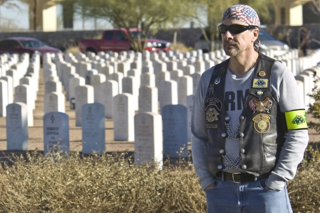 EL PASO, Texas (December 11, 2010) A regional Patriot Guard Rider solemnly observes the Wreaths Across America Dedication Ceremony at the Fort Bliss National Cemetery, Dec. 11. Photo by David Poe.