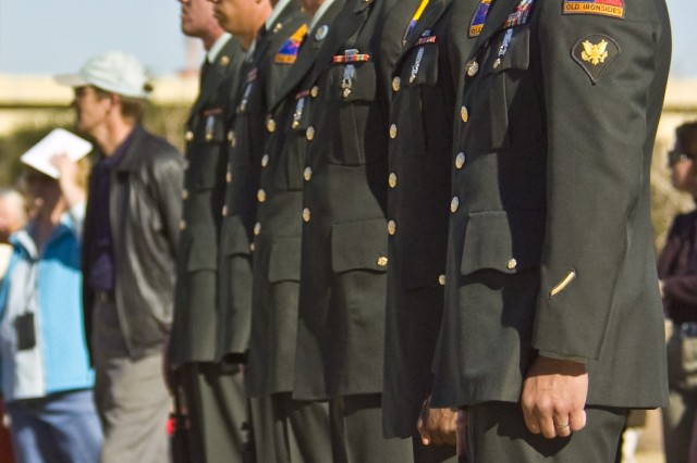 EL PASO, Texas (December 11, 2010) The Fort Bliss Ceremonial Rifle Team, consisting of Soldiers from Special Troops Battalion, 3rd Infantry Brigade Combat Team, 1st Armored Division, stands at the ready during the Wreaths Across America Dedication Ceremony at the Fort Bliss National Cemetery, Dec. 11.