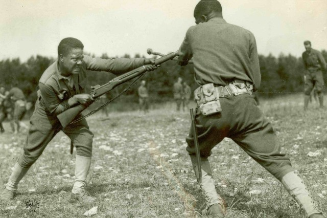 American non-commissioned officers practice bayonet training in France in 1918.  These men, having been taught by French soldiers before them, would then go back to their companies in order to train their fellow Soldiers.