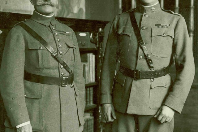 Marshal Ferdinand Foch, commander-in-chief of Allied Forces, and General John J. Pershing, the commander-in-chief of American Expeditionary Forces, discuss tactics and strategy at a conference in France during World War I.