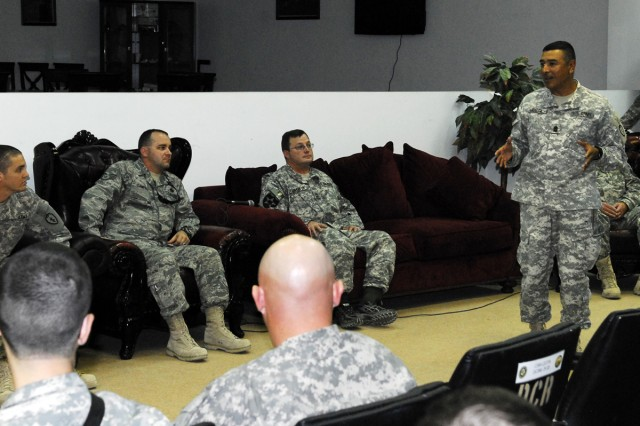 """BAGHDAD - Command Sgt. Maj. Frank Leota, Command Sergeant Major, 25th Inf. Div., speaks to wounded warriors who have returned to Iraq during a question-and-answer session in the U.S. Division - Center headquarters conference room, Dec. 10. The wounded warriors returned for """"Operation Proper Exit,"""" a program which seeks to give service members injured in Iraq, a measure of closure to a difficult period in their lives. (U.S. Army photo by Spc. Daniel Stoutamire, U.S. Division - Center Public Affairs)"""