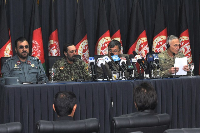 Key leaders of southern Afghanistan - Afghan National Police Maj. Gen. Salim Ihsas, 404th Maiwand zone commander; Afghan National Army Brig. Gen. Abdul Hamid, 205th Corps commander; Kandahar Provincial Governor Tooryalai Wesa; and U.S. Army Maj. Gen. James L. Terry, Regional Command South commander - held a press conference in Kandahar City Dec. 9 to discuss Operation Hamkari. (Photo by Air Force Senior Airman Daryl Knee / 16th Mobile Public Affairs Detachment)