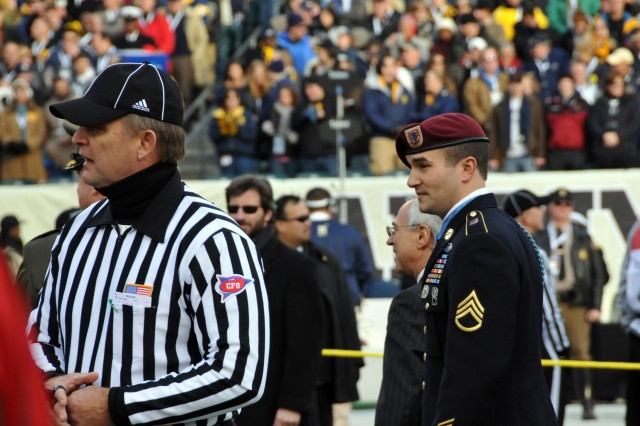 Medal of Honor recipient Staff Sgt. Salvatore Giunta waits to take part in the coin toss for the Army-Navy football game Dec. 11 at Lincoln Financial Center in Philadelphia.