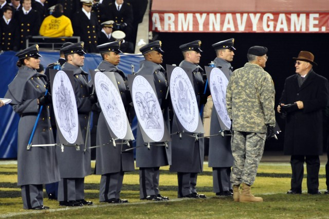 Army Chief of Staff Gen. George W. Casey Jr. and Army Historical Foundation Executive Director retired Brig. Gen. Creighton W. Abrams Jr. reflect after unveiling the designs for three commemorative coins during the Dec. 11 Army-Navy football game.  The coins celebrate the Army's history and heritage.