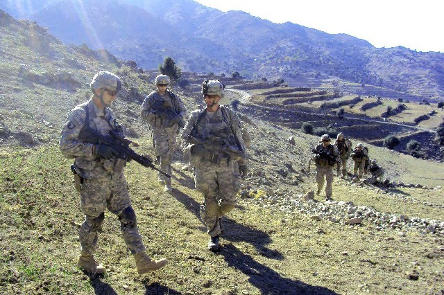 Soldiers assigned to 2nd Battalion, 327th Infantry Regiment, Task Force Bastogne, 1st Brigade Combat Team, 101st Airborne Division, hike the hilly terrain in eastern Afghanistan's Kunar Province Dec. 10, during Operation Eagle Claw II.