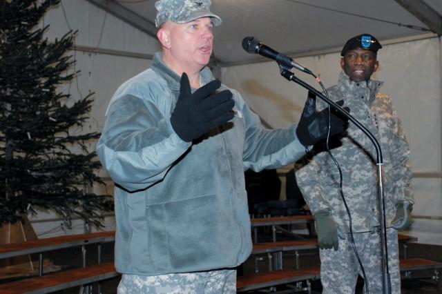 "U.S. Army Garrison Stuttgart Commander Col. Carl D. Bird, left, and U.S. Africa Command Commander Gen. William E. ""Kip"" Ward welcome the crowd to the 2010 garrison Winterfest Dec. 3."