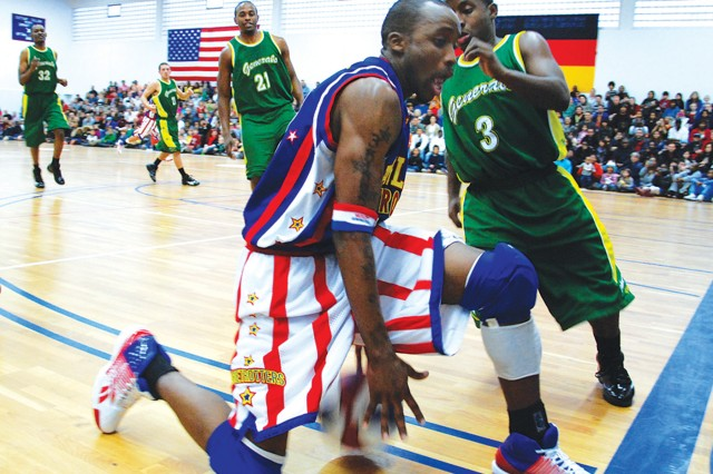 Harlem Globetrotters guard Rocket Rivers (#17) shows off his ball handling skills as Washington Generals players try to steal the ball during the game Dec. 5.