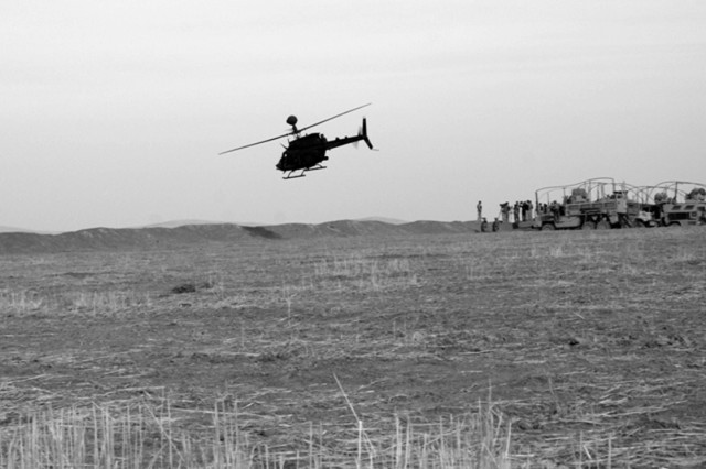 A U.S. Army Kiowa Warrior helicopter flies over U.S. and Iraqi troops during a live-fire exercise near Mosul, Iraq, Dec. 6. The helicopter belongs to the 1st Squadron, 6th Cavalry Regiment, a unit that has conducted several such training exercises with the Iraqi Army since it deployed to Iraq this March.