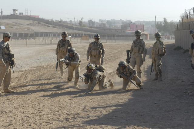 JOINT SECURITY STATION INDIA, Iraq- soldiers assigned to the 2nd Iraqi Army Division, practice three to five second rushes Dec. 3. Soldiers assigned to B Co., 2nd Battalion, 7th Cavalry Regiment, 4th Advise and Assist Brigade, 1st Cavalry Division, worked with their Iraqi counterparts to make them more proficient at their movement drills.