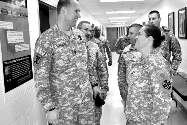 Command Sgt. Maj. Michael Schultz (left), U.S. Army Reserve Command command sergeant major, addresses personnel from First Army, Army Professional Management Command and the 3rd Medical Deployment Support Command after a town hall meeting at Fort Gillem Monday. Schultz discussed promotions, advancements, physical readiness training and professional military education, telling Soldiers leaders need to get back to basics and know about their Soldiers and their Families.