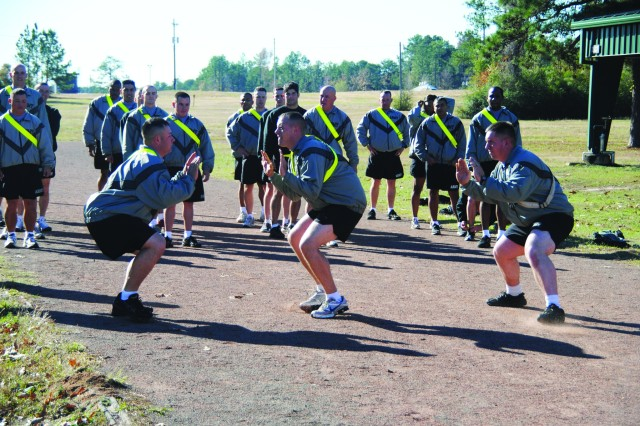 Fort Polk noncommissioned officers participate in a troop movement drill, part of the Army's new Physical Readiness Training Program, during a class hosted by the post's Noncommissioned Officer Academy Dec. 1.