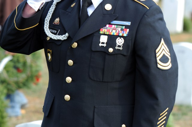 Sgt. 1st Class Christopher Galbusieri, the 3d ESC's Army Force Generation noncommissioned officer in charge and Ft. Lauderdale, Fla. native, renders a salute to a fallen Veteran during the Wreaths Across America ceremony held at the Kentucky Veterans Cemetery Central in Radcliff on Sat., Dec. 11. Galbusieri said that laying wreaths for Veterans was the least he could do to honor the Veterans laid to rest at the Kentucky Veterans Cemetery Central. (U.S. Army photo by Sgt. Michael Behlin)