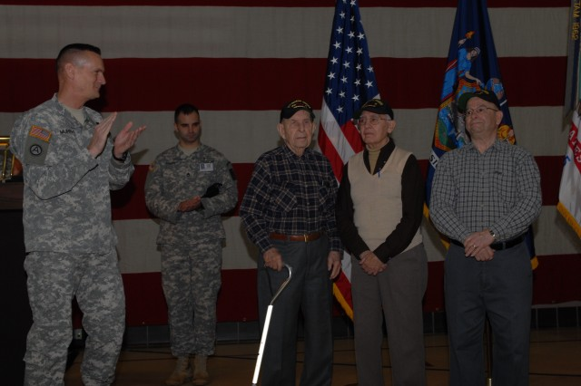 LATHAM, NY--Major Gen. Patrick Murphy, the Adjutant General of New York, leads the applause for three World War II veterans of the New York National Guard's 27th Infantry Division who attended the Guard's 374th Birthday celebration on Dec. 13 at New York State Division of Military and Naval Affairs Headquarters. They are, from left, John Sidur, age 92; John Trudeau, age 98; and Spike Maikkius, age 87.