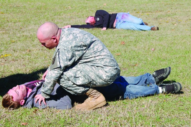 Bayne-Jones Army Community Hospital staff respond to a wreck with multiple patients and severe injuries at a mass casualty exercise held Dec. 2, at BJACH.