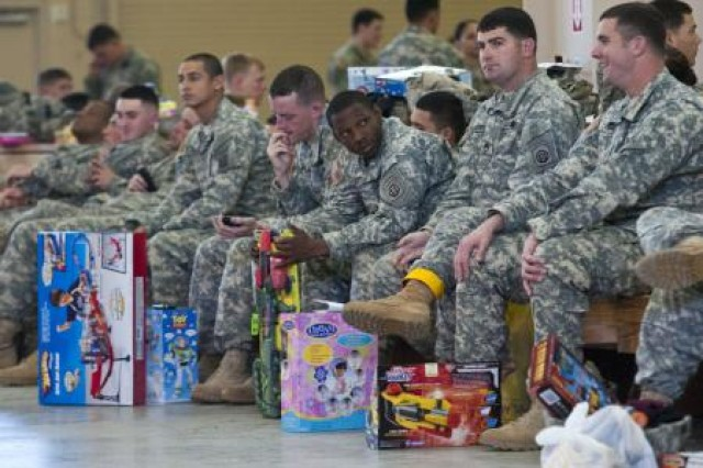 Paratroopers line up in the early morning of Dec. 10 to donate a toy for local children in need, while hoping to earn foreign jump wings during Operation Toy Drop on Fort Bragg, N.C. The 13th annual Randy Oler Memorial Operation Toy Drop is being held this December on Fort Bragg, N.C. U.S. Army and Air Force service members are donating thousands of toys to help brighten the holidays for children and families in need.