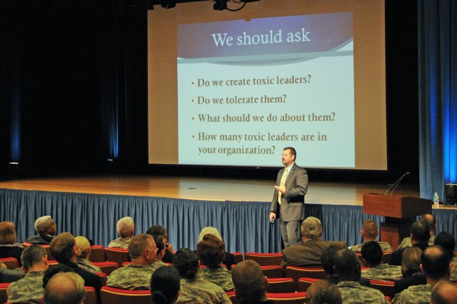 Retired Col. George E. Reed, associate professor of leadership studies at the University of San Diego, speaks about toxic leadership Dec. 7, at the Pentagon.
