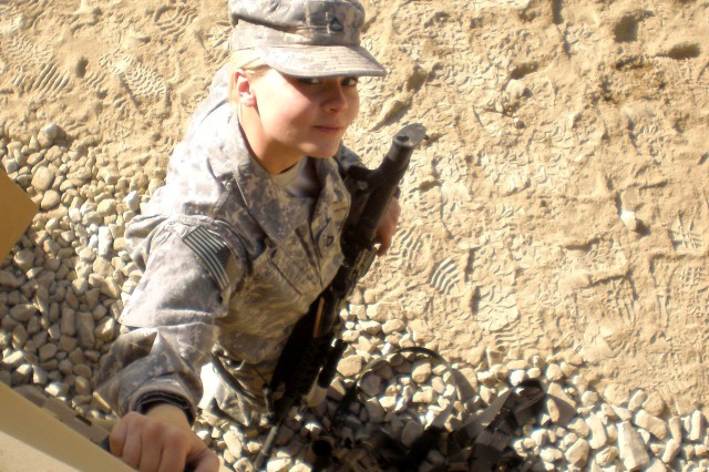 Private 1st Class Stephanie Daniels stands next to the Mine Resistance Ambush-Protected vehicle she drives as a member of the Personnel Security Detachment of the 101st Sustainment Brigade.