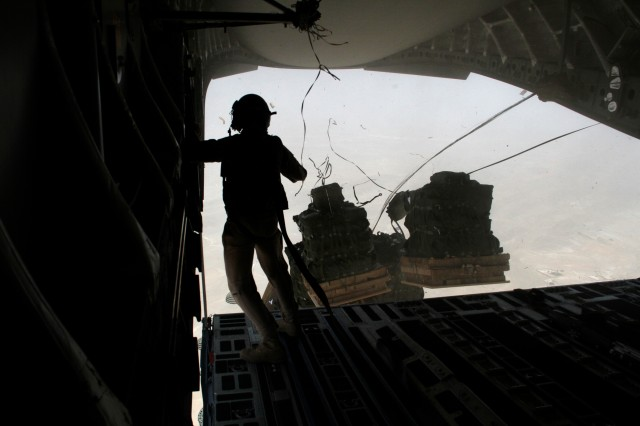 Deployment_22:  An Airman looks on as bundles of JP8 fuel fall to the ground during a fuel airdrop above Afghanistan, Aug. 14. In 2010, petroleum personnel ordered, tracked, and delivered more than 1 billion gallons of fuel to warfighters on the ground.  While most fuel is delivered via tanker trucks, some of the most remote forward operating bases get their fuel supplied via air drops.  Photo by Army Sgt. David Reardon, 1st Sustainment Brigade Public Affairs.