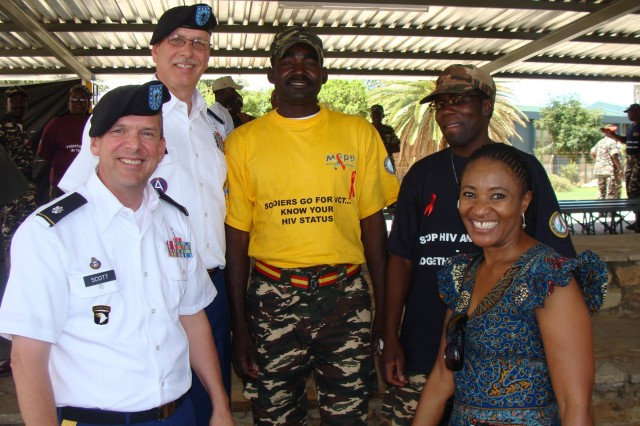 Col. Jonathan McGraw, U.S. Army Africa's command chaplain, and Lt. Col. Clyde Scott, deputy command chaplain, participate in the 2010 Namibia Defence Force World AIDS Day ceremony in Windhoek, Namibia.