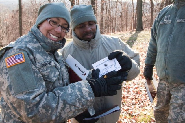 Non-Commissioned Officers from the Army Research, Development and Engineering Command (RDECOM) look at a Revolutionary-era musket ball during a visit to Morristown National Historic Park Dec. 9.