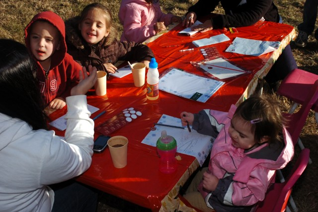 SALADO, Texas - Children write letters to Santa during the 3rd Battalion, 82nd Field Artillery Regiment, 2nd Brigade Combat Team, 1st Cavalry Division holiday party at the Salado Tree Farm in Salado, Texas Dec. 12.