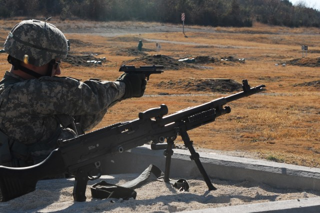 FORT HOOD, Texas - Spc. Patrick Dunkoe, from Long Beach, Calif., a Blackhawk crew chief for Company C, Task Force Spear Head, 1st Air Cavalry Brigade, 1st Cavalry Division, fires his 9mm pistol during a timed and evaluated downed aircraft training exercise Dec. 10. The crew utilized their warrior skills to navigate from point to point, fire all of their weapons systems and evacuate simulated casualties.