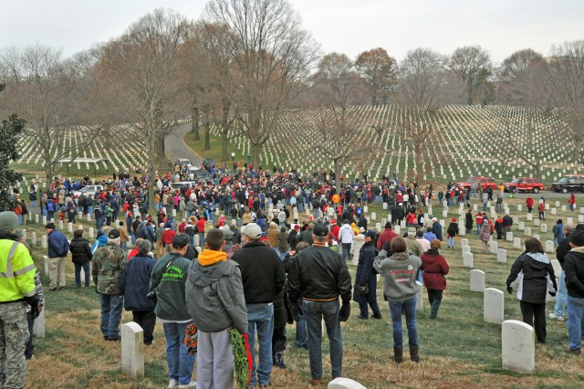 Hundreds of volunteers braved deep-freeze chills Dec. 11, to place 24,000 wreaths on as many graves at Arlington National Cemetery.