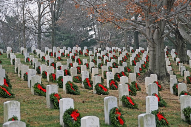 Volunteers adorned 24,000 graves at Arlington National Cemetery with donated wreaths from Morrill Worcester, founder of Worcester Wreath Company, Dec. 11. Worcester started the Arlington wreath-laying 18 years ago with 5,000 wreaths.