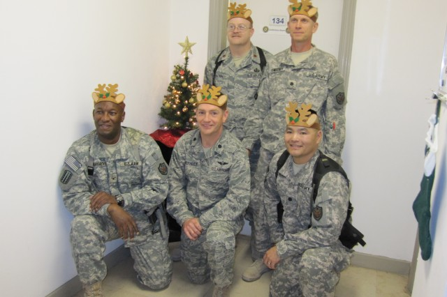 Army members of the MNSTC-I team gather for a holiday photo, complete with antlers. Front row (L to R): Col. Sammie Hargrove, Lt. Col. Kevin Muckerheide and Lt. Col. Victor Nakano. Back row (L to R): Maj. John Caudill and Lt. Col. Joseph Sweeney.