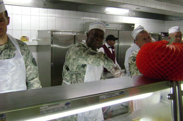 Col. Sammie Hargrove, USASAC liason officer to MNSTC-I, serves Thanksgiving dinner to approximately 800 civilians and service members at FOB Union III.