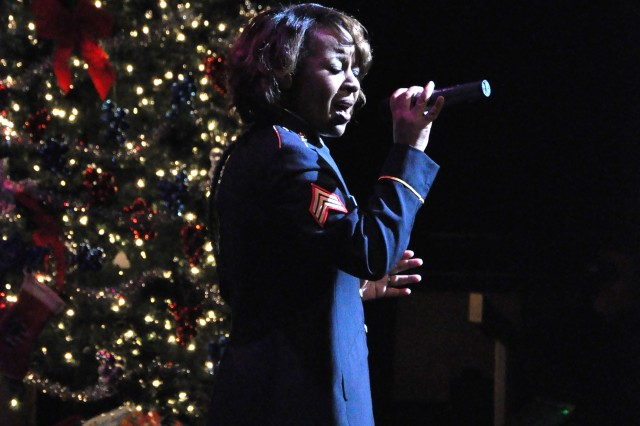"""(FORT McPHERSON, Ga. - Dec. 12, 2010)   Vocalist Sgt. Shirley Dirden sings a heartfelt rendition of """"Have Yourself a Merry Little Christmas"""" to the more than 2,500 guests attending The Army Ground Forces Band's 25th Annual Holiday Concert."""