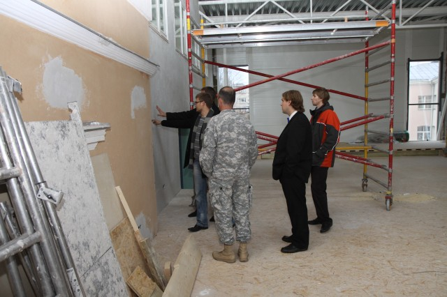 During a recent visit to Tantu Estonia, Col. John Kem, Commander, USACE Europe District is shown where the historical building and the new addition marry up by members from the Estonia contactor AS Tartu Ehitus.