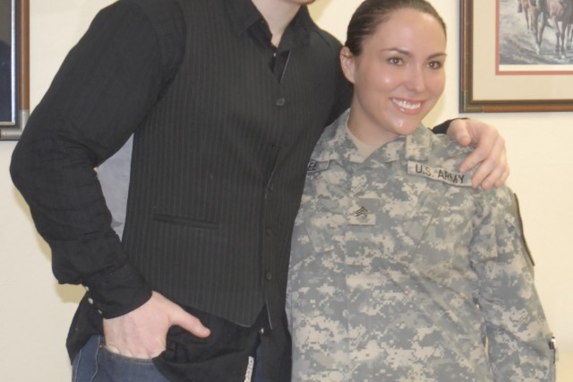 Sgt. Margie Allee, from Headquarters and Headquarters Troop, 3rd Brigade Combat Team, 1st Cavalry Division, poses for a photo with Sheamus, a World Wrestling Entertainment wrestler on Fort Hood, Dec. 11.