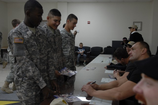 A line of Soldiers from 3rd Brigade Combat Team, 1st Cavalry Division, wait for autographs from World Wrestling Entertainment wrestlers on Fort Hood, Dec. 11.