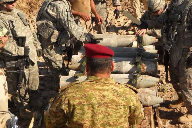 Explosives technicians from 8th Iraqi Army Division, joined by members of the 3rd Armored Cavalry Regiment and the 75th Explosive Ordnance Disposal Company secure a large stockpile of munitions at Joint Security Station Hamiyah.  The Soldiers used the detonation as a joint training exercise between Iraqi and U.S. bomb disposal experts.