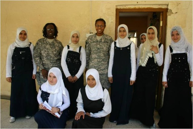 Pfc. Rolanda Geneus from Orlando, Fla. and Pfc. Donya Glover, both medics with Headquarters and Headquarters Troop, 3rd Squadron, 3rd Armored Cavalry Regiment, visited the Al Sadiqa Middle School in Diwaniyah. The purpose for the visit was to reach out to local teenage girls and discuss cultural differences as well as what it's like to be a teen in Iraq.