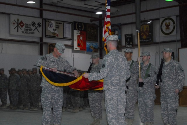 Brigade TOA 3: Col. Richard Gallant and Command Sgt. Maj. Stephen Corrow, both leaders with Florida National Guard 53rd Infantry Brigade Combat Team, furl the 53rd's unit colors during a Transfer of Authority Ceremony on Camp Arifjan, Kuwait, Dec. 15. Soldiers with the New Hampshire National Guard 197th Fires Brigade have now assumed responsibility for convoy security and camp operations in Kuwait. The two National Guard units have been training side-by-side in Kuwait to ensure a smooth transition.