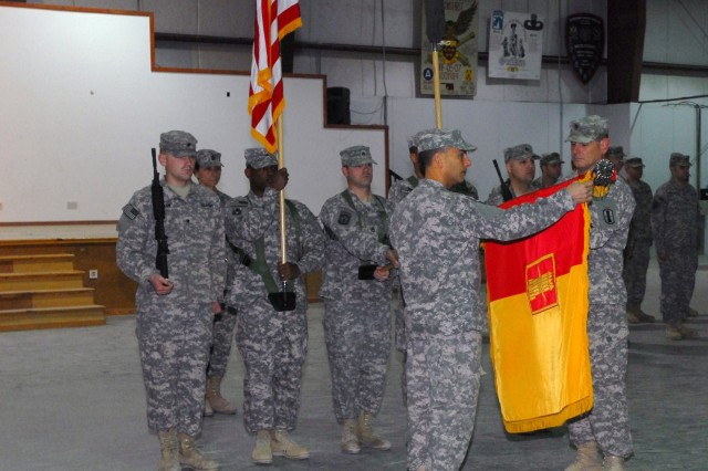 Brigade TOA 5: Col. Peter Corey and Command Sgt. Maj. Thomas Considine, leaders with the New Hampshire National Guard 197th Fires Brigade, unfurl the unit colors during the Transfer of Authority Ceremony with the 53rd Infantry Brigade Combat Team on Camp Arifjan, Kuwait, Dec. 15. The 53rd IBCT is going home after serving one year in the desert, and the 197th FB has now taken on the convoy security and camp operations missions in Kuwait.