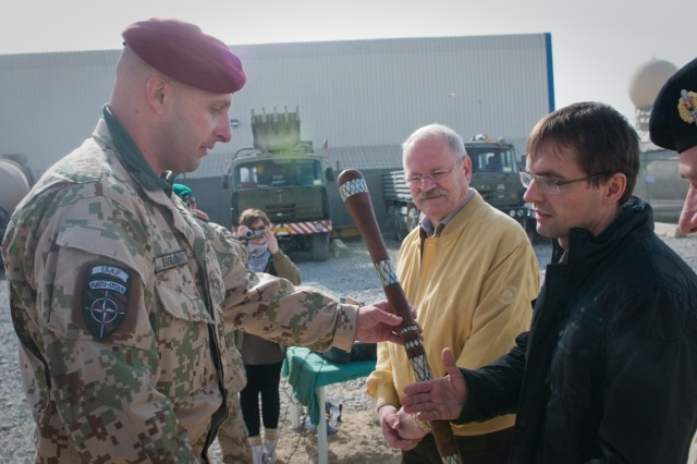 101215-A-5634G-002: Slovak President Ivan Gasparovic watches Lt. Col. Peter Svrlo, Slovak contingent commander, presents a gift to Slovak Minister of Defense Lubomir Galko during a presidential visit to the Slovak contingent in International Security Assistance Force Regional Command South Dec. 15 on Kandahar Airfield, Afghanistan. (U.S. Army photo by Spc. Edward A. Garibay, 16th Mobile Public Affairs Detachment)