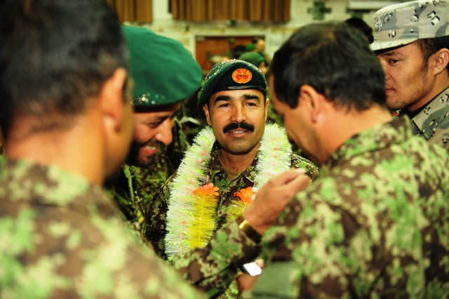 Afghan National Army and Afghan National Police celebrate graduating from the ANAAca,!a,,cs Bridmal Sergeants Major graduation ceremony at Kabul Military Training Center, Dec. 14.
