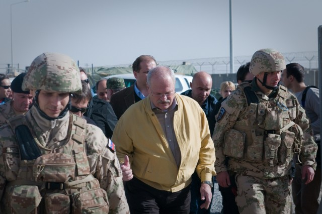 Slovak President Ivan Gasparovic walks with his troops during a visit to the Slovak contingent Dec. 15 at Kandahar Airfield, Afghanistan. (U.S. Army photo by Spc. Edward A. Garibay, 16th Mobile Public Affairs Detachment)